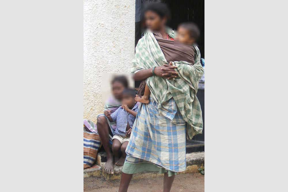 Kosi (name changed, standing) was plucking vegetables in her courtyard when troopers overpowered her and raped her. Bali heard her cries and witnessed the brutal rape.