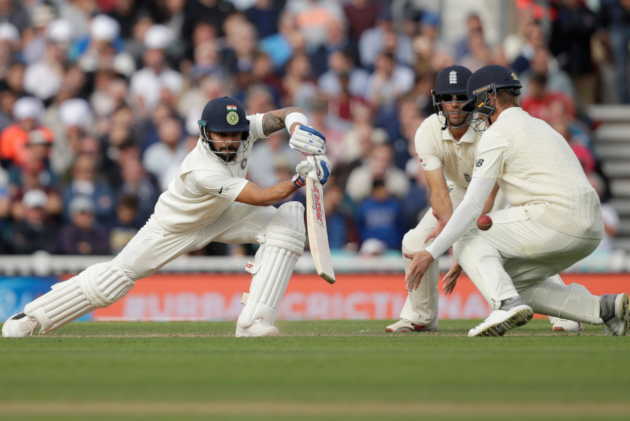 India captain Virat Kohli hits a shot during the fifth Test against England at The Oval, London. (AP Photo/Matt Dunham)