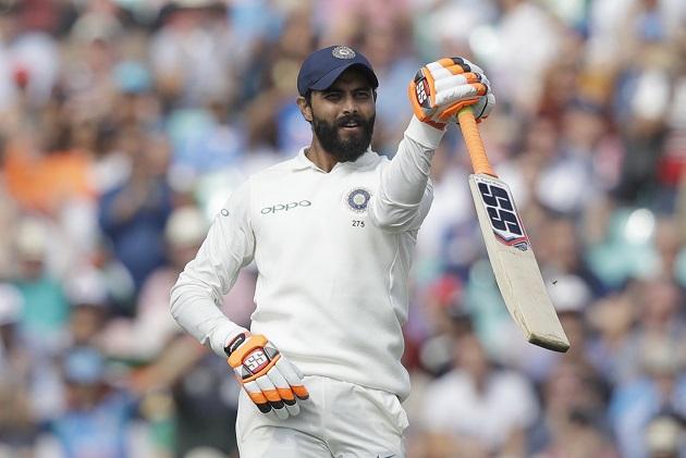 Ravindra Jadeja celebrates reaching 50 runs during the fifth Test between England and India at The Oval, London. (AP Photo/Matt Dunham)