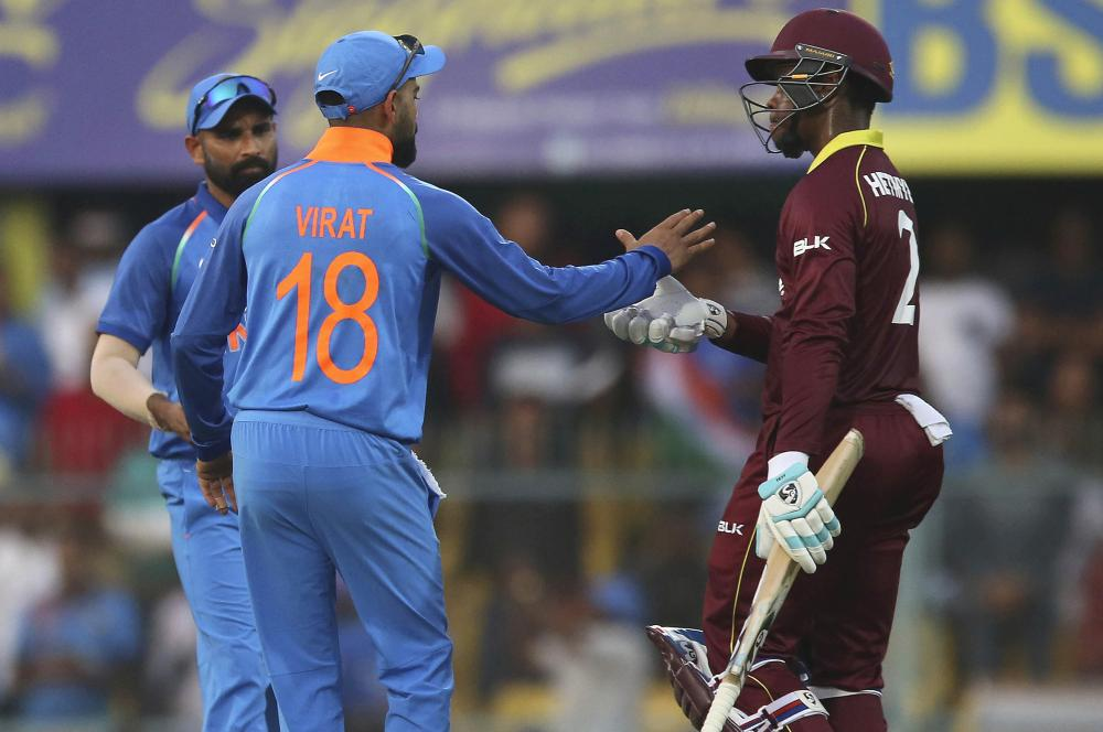 India captain Virat Kohli greets Shimron Hetmyer as the West Indies batsman leaves the field after his dismissal during the first ODI match in Guwahati on October 21, 2018. (AP Photo/Anupam Nath)