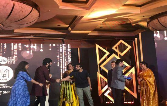 Karan Asnani and team receiving the Golden Gateway Award