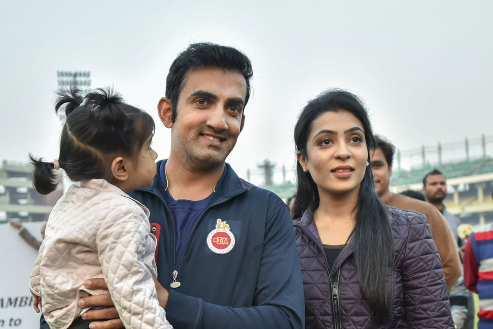 Gautam Gambhir poses for photos with wife Natasha Jain and daughter, on the last day of Ranji Trophy match between Delhi and Andhra at Feroz Shah Kotla Ground in New Delhi on December 9, 2018.