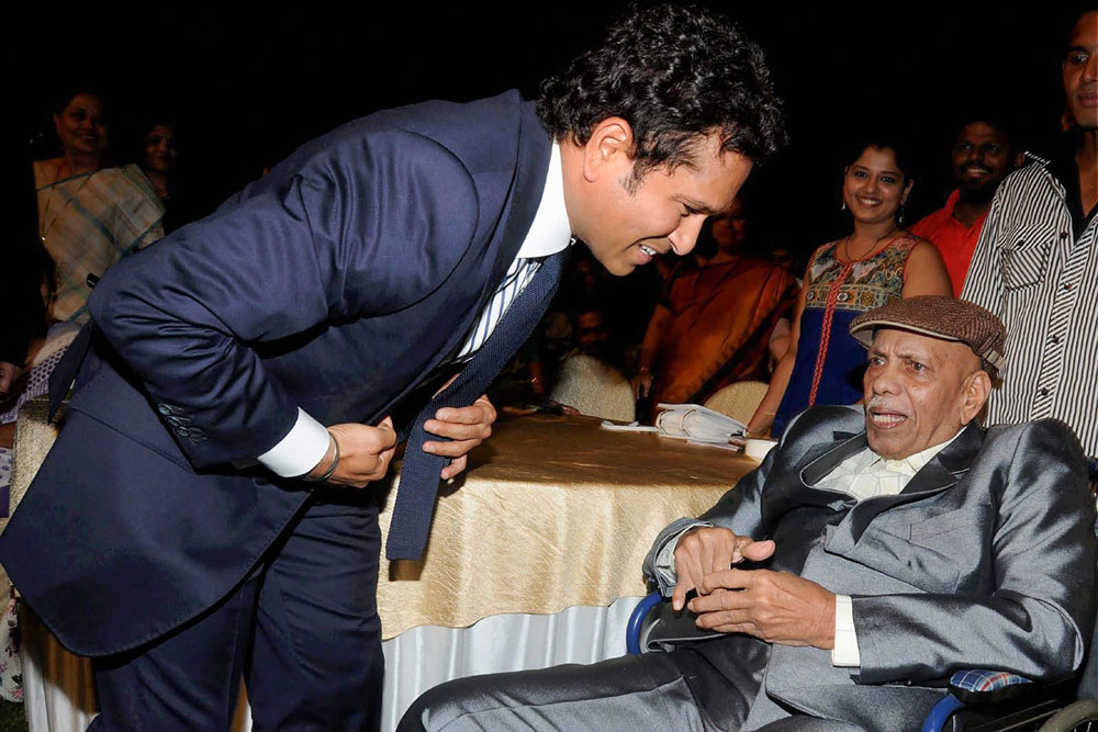 In this May 24, 2017 file photo, cricket coach Ramakant Achrekar is seen with cricket legend Sachin Tendulkar during the premiere of his biopic Sachin: A Billion Dreams in Mumbai.