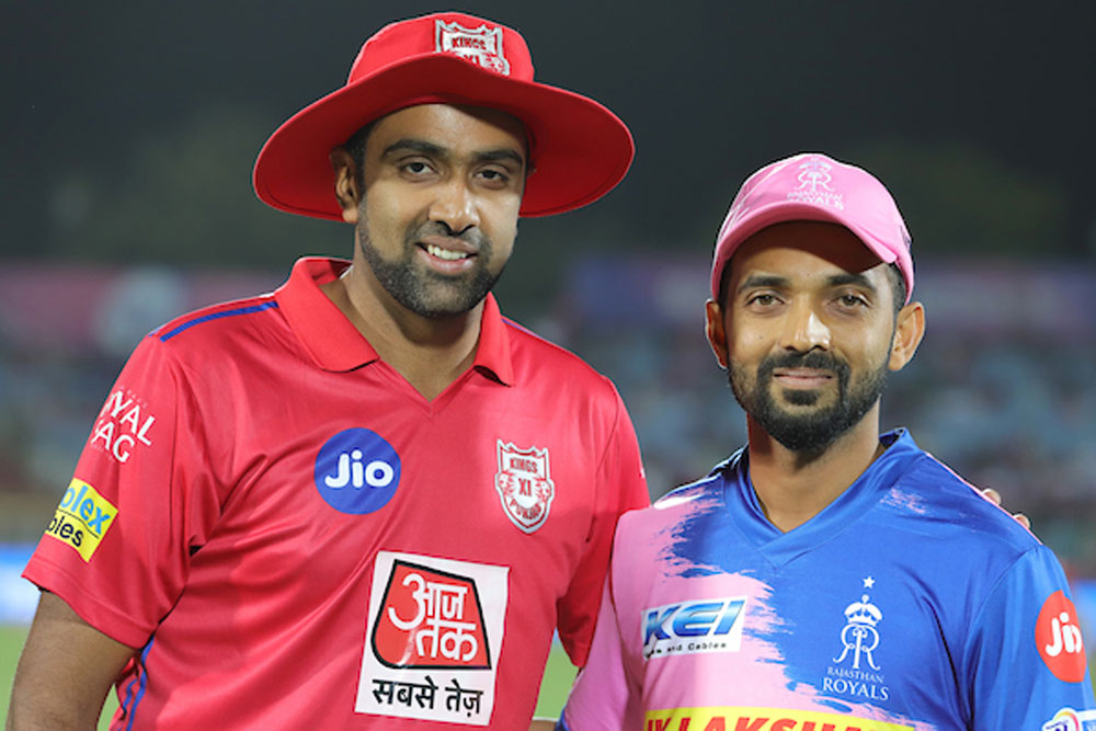 Rival captains R Ashwin (red) and Ajinkya Rahane at the toss of their IPL match in Jaipur