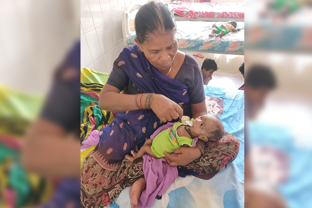 A malnourished child being looked after at a NRC