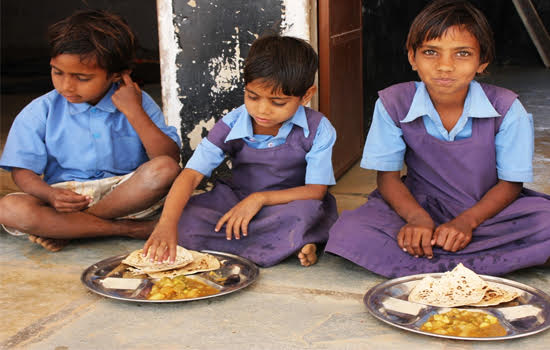 School children enjoying nourishing mid-day meal