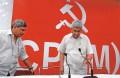 <b>Who's the better man?</b> Yechury and Karat at a CPI(M) meeting
