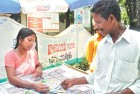 <b>What's the prize</b> A lady vendor selling lottery tickets on the roads of Kochi
