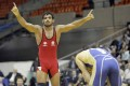 Sushil Kumar reacts after defeating Russia s Alan Gogaev, during their 66kg freestyle final match at the World Wrestling Championships in Moscow.
