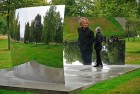 <b>Mirror, Mirror</b> Anish Kapoor poses with his stainless steel installation, C-Curve, near the Serpentine gallery in Hyde Park, London, on September 27, 2010