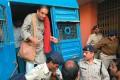 <b>Hard court</b> Binayak Sen being brought to the Raipur court on December 24