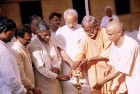 <b>Close-knit?</b> Swami Aseemanand at a function in Gujarat with chief minister Narendra Modi and other state BJP leaders. The swami has worked extensively in the Dangs.