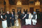 <b>New men, old roles</B> PM Manmohan Singh and President Pratibha Patil with the new ministers before they were sworn in