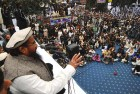 <b>In Mourning</b> Hafiz Saeed addresses crowds