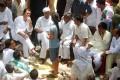 <b>Sympathetic Ear</b> Rahul meets Bhatta-Parsaul villagers with Digvijay Singh
