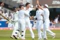 Facing page, England celebrates Dravid's wicket on Day 5 of the Lord's Test