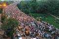 <b>Sunday, August 21</b> <i>Ranjit Singh Flyover, New Delhi</i> <p> A sea of supporters troop towards the Ramlila Maidan from India Gate to stand fast with Anna Hazare