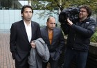 Pakistani fast bowler Mohammad Asif, left, 28, arrives at the Southwark court in London