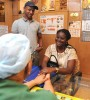 <b>Reach out</b> Dr Anoop Gupta with South African Babriola and Kenyan Antony
