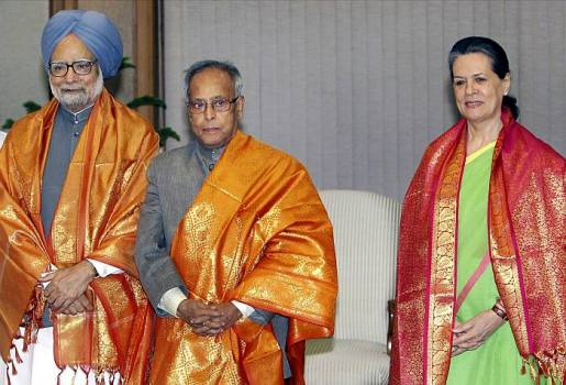 Prime Minister Manmohan Singh, Finance Minister Pranab Mukherjee and Congress party president Sonia Gandhi pose for the media after Mukherjee's name was nominated for the post president during an UPA meeting, in New Delhi.