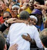 Obama embraced by a supporter on his campaign at Dayton, Ohio