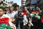 Palestinians in Gaza City carry children killed in an Israeli airstrike