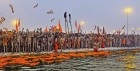 Naga sadhus of the fiery Juna akhara get ready for the Shahi snan on Makar Sankranti day at the Sangam, Allahabad, Jan 14