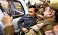 <b>Caught napping?</b> A. Raja being produced in court in connection with the 2G spectrum allocation scam in Delhi