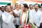 <b>Sweet victory</b> KPCC president G. Parmeshwar celebrates with M.V. Rajasekaran