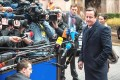 <b>Done deal</b> Cameron faces the media