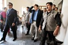 <b>Payback</b> Musharraf, surrounded by guards, arrives at the Sindh High Court on March 29