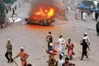 <b>Whose war</b> Hifazat activists on the rampage set fire to a police jeep in Dhaka, May 5