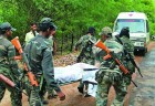 <b>A grisly end</b> Security personnel carry the body of a victim
