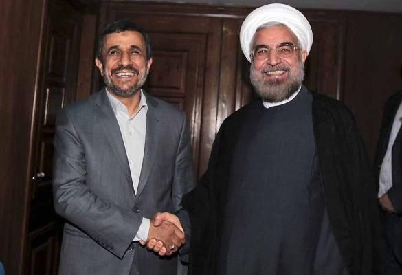 Outgoing Iranian President Mahmoud Ahmadinejad, left, shakes hands with President elect Hasan Rowhani, during a meeting at Rowhani's office, in Tehran, Iran. Rowhani has vowed for better ties with the world, and aims to reduce the West's sanctions against Iran over the country's disputed nuclear program.