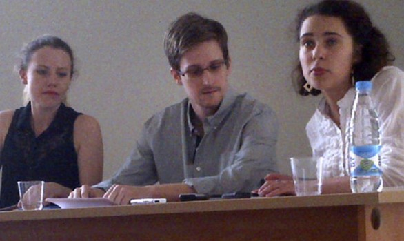 Jul 12, 2013 In this image provided by Human Rights Watch, NSA leaker Edward Snowden, center, attends a news conference at Moscow's Sheremetyevo Airport with Sarah Harrison of WikiLeaks