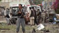 Security officials investigates the scene of an attack near the Indian consulate in the city of Jalalabad, Afghanistan.