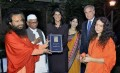 (From left) Swami Chidanand, Anna Hazare with South Carolina governor Nikki Haley at the launch of the encyclopaedia