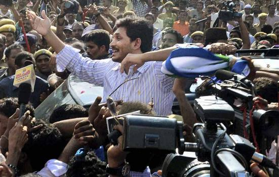Sep 24, 2013: YSR Congress Party President YS Jagan Mohan Reddy greets his supporters after he was released from the Chanchalguda Jail in Hyderabad.
