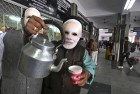 <b>Tea-talk</b> A BJP man in a Modi mask