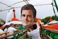<b>Task cut out</b> Congress supporters fix a cut-out of Rahul Gandhi in Calcutta