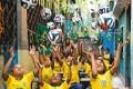 <b>Head This</b> Children throw up FIFA 2014 Cup balls in a public classroom in Rio