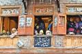 Kashmiri women watch a Moharram procession in Srinagar