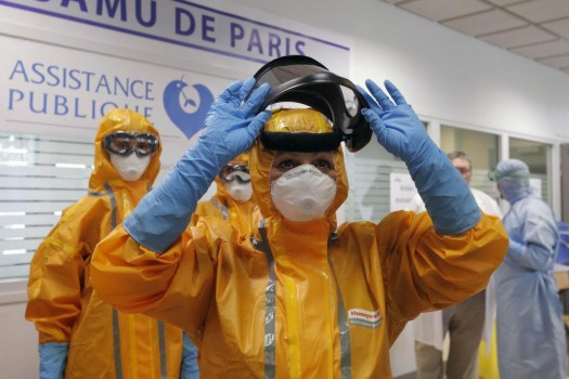 A medical team of the Paris emergency unit show their protective suits during a training session to take care of suspected Ebola cases during a presentation to the press, in Paris.