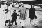 <b>In a different mould</b> Feroze Gandhi with a young Rajiv Gandhi, after seeing off Jawaharlal Nehru and Indira Gandhi at Palam airport in Delhi. With him are Vijayalakshmi Pandit's daughters  Rita (left) and Chandralekha.