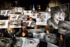 <b>Eye am Charlie</b> NY mourners hold signs depicting the slain cartoonists' eyes