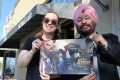 <B>Dishum...</b> Eileen Alden and Manchanda with the first issue of <i>Super Sikh</i>