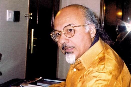 T.J.S. George
