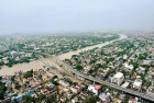 <b>City Float</b> Muddy water fills every blank in this shot of flood-hit Chennai