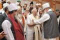 <b>Touched</b> Sufi scholars with Modi