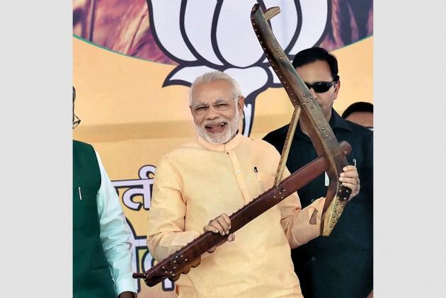 Has Modi Junked Gujarat Model?